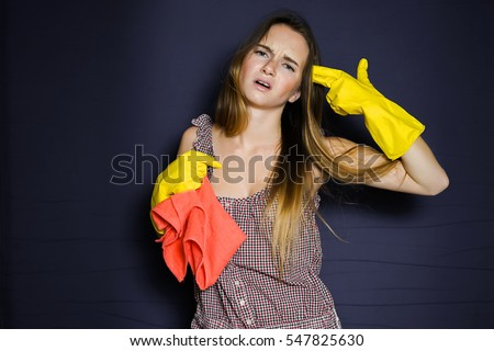 Photo of  Tired stressed housewife after cleaning.Hand gesture of a gun.Angry woman