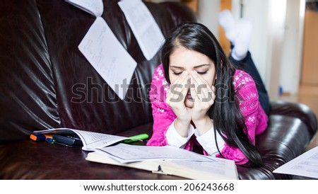 Tired student having a lot to read. Student girl with lot of books around. Student is studying. Study up.