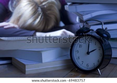Tired Student Sleeping on Books