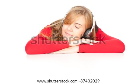 tired teenage girl with headphones leaning on the table, white background