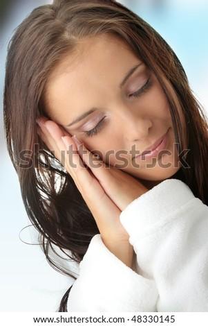 Tired woman in white bathrobe