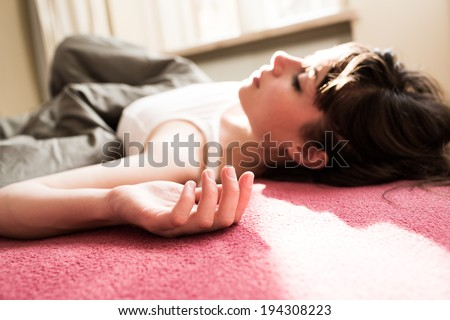 Tired woman laying in bed, relaxing in a close up shot