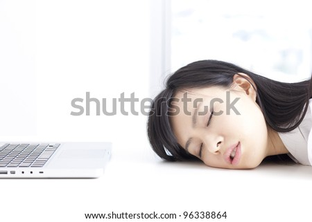 tired woman sleeping at laptop