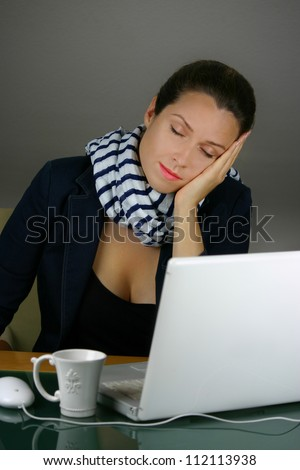 Tired woman sleeping at office