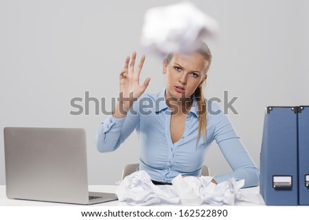 Tired woman throwing out office documents