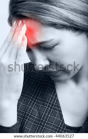 Tired woman with big headache or migraine