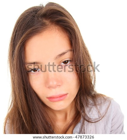 Tired woman with empty and bored eyes. Mixed race asian / caucasian model isolated on white background.