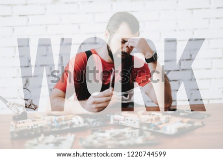 Tired Worker Makes Repair of Broken PC Boards. Computer Service Employee is Depressed. Concept of Exhausting Job. Despaired Young Man Does Hard Work. Overtime at Technician Maintenance Center. Stockfoto ©