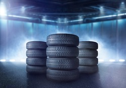 Tires are stacked in a warehouse