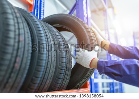 Tires in a tire store, Spare tire car, Seasonal tire change, Car maintenance and service center. Vehicle tire repair and replacement equipment.