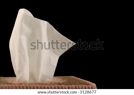 Tissue Box - black background - close-up of paper handkerchief in a decorative plastic canvas box.
