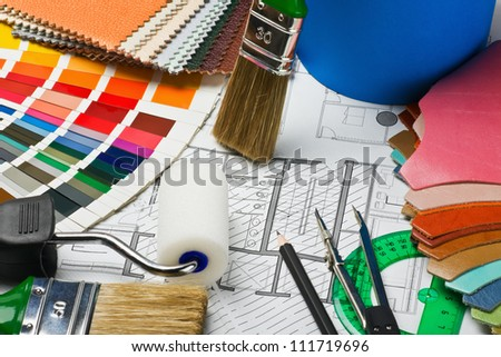 tissue samples, leather, paints and paint repair on the architectural plan.This composition recommend using advertising tools and materials for the repair of articles in magazines and on the Internet.