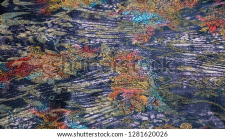 tissue, textile, cloth, fabric, material, texture. Textile stuffed with blue flowers.  cloth, typically produced by weaving or knitting textile fibers. #1281620026