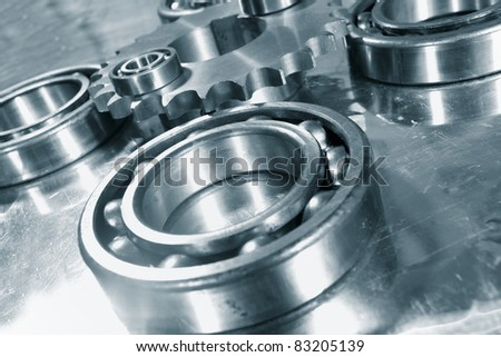 titanium ball-bearings, gears and engineering, blue toning concept