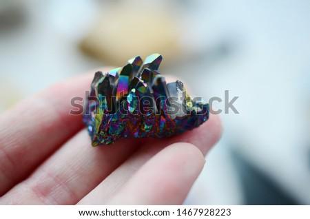 Titanium Flame Aura Quartz being held in woman's hand. Rainbow Titanium plated quartz Crystal points, Rainbow Flame Aura. Witchy crystals for a healing alter, reiki energy healing.