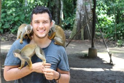 Titi monkeys and its trainer