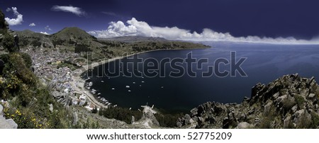 titicaca lake high altitude in andes between Bolivia and Peru city of Copacabana near isla del sol and Isla de la luna sunny day with nice white clouds in blue sky and water panorama with copy space