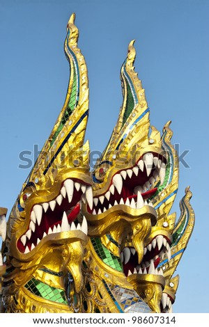 Title/ Nagas be proud Description/ Naga or Thai dragon be proud and roar in the blue sky. Caption/ I took it in early morning because I needed the soft light and blue sky.