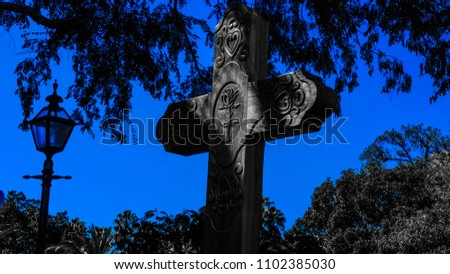title unknown by J.Hamilton black and white photo with blue sky wooden spanish rose cross #1102385030