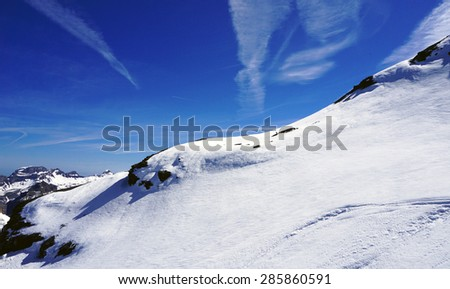 Titlis snow mountains white and vivid blue sky, Swiss #285860591