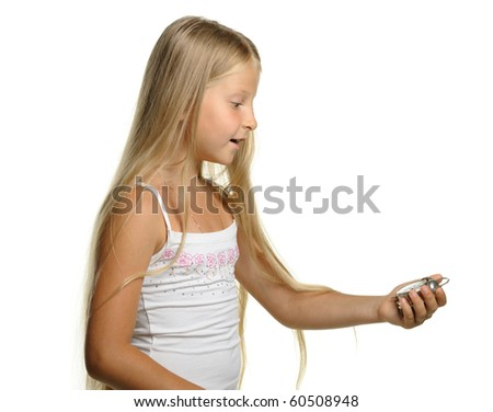 To be late. The girl with amazement looks at an alarm clock. It is isolated on a white background