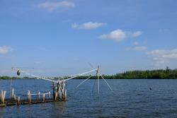 to catch fish and blue sky background at Pak Phanang River,Nakhon Si Thammarat