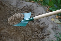 To dig in the sand.Shovel.