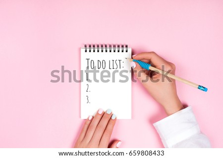 To do list in spiral notepad. Trendy pink background, flat lay style. Foto d'archivio ©
