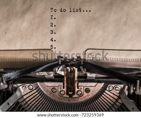to do list words typed on a Vintage Typewriter. Mechanisms close up. Typing on old typewriter #723259369
