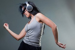 To enjoy music,  girl dance with a ear-phones