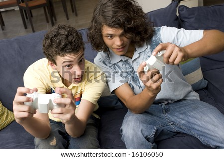 To guys play video games on a couch