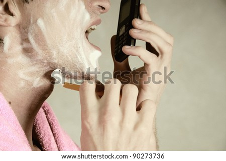 To shave and speak on phone