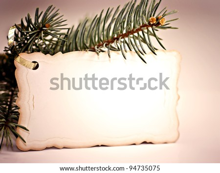 To spruce branch hanging Christmas greeting cards.
