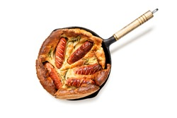 Toad in the hole, Sausage Toad, traditional English dish of sausages in Yorkshire pudding batter. isolated on white background