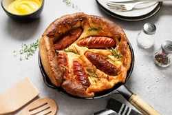Toad in the hole, Sausage Toad, traditional English dish of sausages in Yorkshire pudding batter.