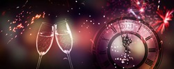 toast at the happy new years eve 2021 with champagne glasses and firecrackers at midnight, happy new year celebration with firewoks light effects around count down clock