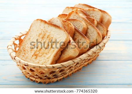Toast bread in basket on blue wooden table ストックフォト ©