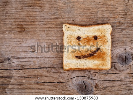 Toast Bread with happy face painted with hazelnut chocolate spread