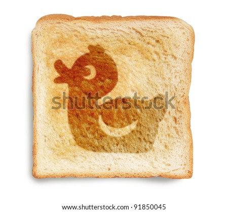 toast bread with rubber duck picture burn mark isolated on white background