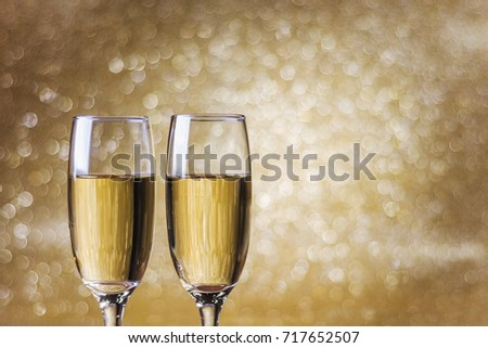 Toast champagne, new year, golden bokeh background #717652507