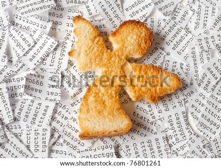 Toast in a form of angel with a background of a tore DNA sequence