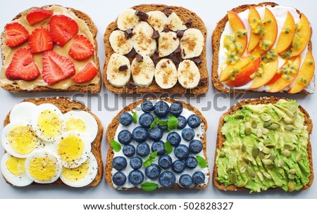 Shutterstock Toast party - strawberry/peanut butter, honey/banana/cinnamon/dark chocolate, greek yogurt/peach/passion fruit, egg/salt+pepper, greek yogurt/blueberries/mint, avocado/pumpkin seeds/lemon/salt+pepper