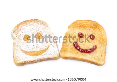 Toast with a smile of powdered sugar and jam isolated on white background