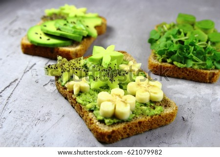 toast with avocado,banana and kiwi.vegetarian food #621079982