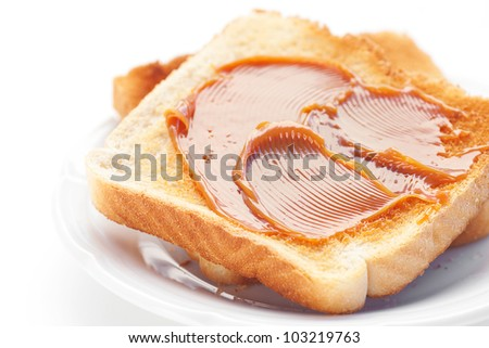 toast with caramel isolated on white