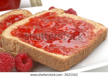 Toast with home made raspberry jam and raspberries.