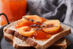 Toast with jam. Apricot jam with berries. Fruit jam for Breakfast. Fresh and healthy Breakfast with toast