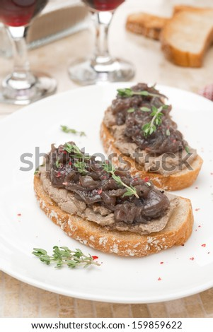 toast with liver pate, caramelized red onion and thyme, vertical close-up