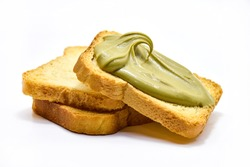 toast with pistachio cream lying on plain toasts isolated on white.