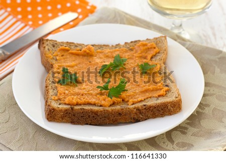 toast with salmon spread and parsley on the plate